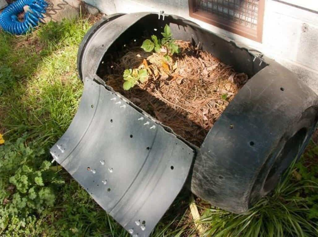 A compost tumbler recycling green waste